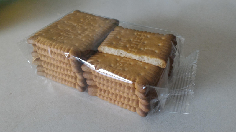 [image: a packet of 12 biscuits with 1 biscuit missing half of itself]